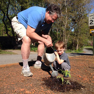 Dan gardening with grandson Gil