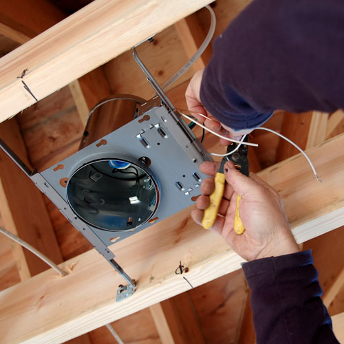 electrician installing a lighting fixture